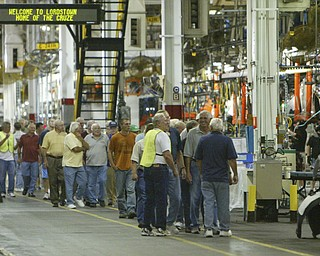 ROBERT  K.  YOSAY  | THE VINDICATOR --..people walk the line as the plant was opened to the public on Thursday..The Lordstown Complex is a General Motors automobile factory in Lordstown, Ohio comprising three facilities: Vehicle Assembly, Metal Center, and Paint Shop. The plant opened in 1966. Lordstown currently builds the global Chevrolet Cruze compact car.The plant welcomed over 9000 visitors to view the  Metal Center ( west plant) and the asembly plant on Thursday.--30-..(AP Photo/The Vindicator, Robert K. Yosay)