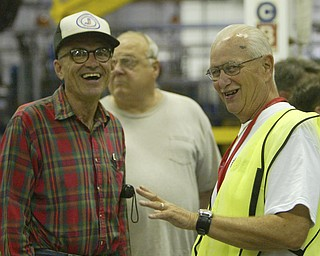 ROBERT  K.  YOSAY  | THE VINDICATOR --..Explaining how robots move the cars and parts on the line is Darwin cooper of Austintown - (Green vest)  he is talking to Gene Cecil of Austintown ( plaid shirt) and behind them is Todd Hausch of orwell ( hidden)..The Lordstown Complex is a General Motors automobile factory in Lordstown, Ohio comprising three facilities: Vehicle Assembly, Metal Center, and Paint Shop. The plant opened in 1966. Lordstown currently builds the global Chevrolet Cruze compact car.The plant welcomed over 9000 visitors to view the  Metal Center ( west plant) and the asembly plant on Thursday.--30-..(AP Photo/The Vindicator, Robert K. Yosay)