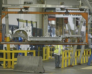 ROBERT  K.  YOSAY  | THE VINDICATOR --..Carriage assembly moves down the line at the West Plant..The Lordstown Complex is a General Motors automobile factory in Lordstown, Ohio comprising three facilities: Vehicle Assembly, Metal Center, and Paint Shop. The plant opened in 1966. Lordstown currently builds the global Chevrolet Cruze compact car.The plant welcomed over 9000 visitors to view the  Metal Center ( west plant) and the asembly plant on Thursday.--30-..(AP Photo/The Vindicator, Robert K. Yosay)