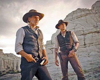 "Harrison Ford and Daniel Craig star in the sci-western ""Cowboys and Aliens."""
