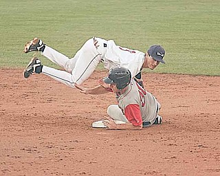 Mahoning Valley's KC Serna is upended by Lowell's Travis Shaw during a New York-Penn League game Thursday at Eastwood Field in Niles. The Scrappers fell to the Spinners, 10-7.