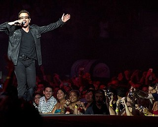 Bono, of the rock group U2, performs in concert as part of U2's 360 Tour at the New Meadowlands Stadium in East Rutherford, NJ, Wednesday, July 20, 2011.  (AP Photo/Charles Sykes)