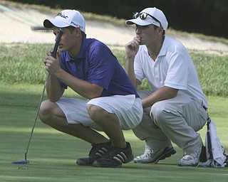 ROBERT  K.  YOSAY  | THE VINDICATOR --..Double eyes as Joe Benson Left and his golf partner -Will Kefler eye a putt. -- The Vindicator Greatest Jr. Golfer of the Valley -at Trumbull Country Club in Warren -.--30-..(AP Photo/The Vindicator, Robert K. Yosay)