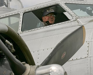 JESSICA M. KANALAS  | THE VINDICATOR..Dick (Richard) Ames gets into the pilots seat and looks out after landing...-30-