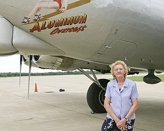 JESSICA M. KANALAS  | THE VINDICATOR..Dixie Kosovec stands next to the plane art. ..-30-