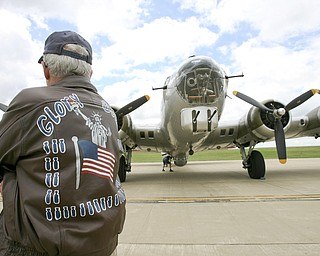 JESSICA M. KANALAS  | THE VINDICATOR..Dick (Richard) Ames wears his flight jacket from  his service in WWII...-30-