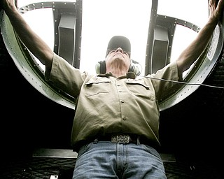 JESSICA M. KANALAS  | THE VINDICATOR..Rich Krikorian, crew chief and mechanic for the B-17 tours, stabilizes himself as the plane descends and lands. ..-30-
