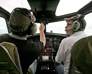 JESSICA M. KANALAS  | THE VINDICATOR..Co-pilots Dan Bowlin and Kent Holiday fly the B-17 on its tour that left from the Youngstown Airport...-30-