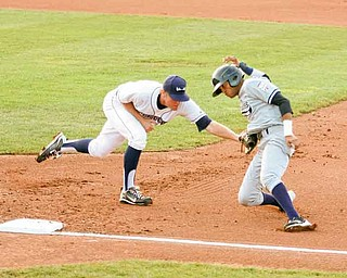Mason Williams, can't avoid the tag of Mahoning Valley Scrappers first baseman Jerrud Sabourin during Thursday's game at Eastwood Field. The Scrappers won 4-0.