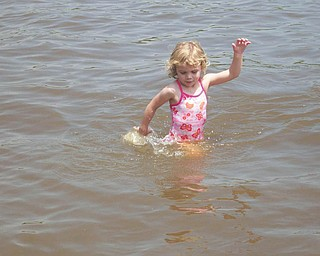 Rachel Lamb, 4, is playing in Lake Roaming Rock, Roaming Shores, Ohio. Her parents are Bruce and DeAnne Lamb of Canfield.