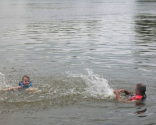 Ryan Lamb, 6, and his Uncle Mark David of Cleveland, Ohio, are at Lake Roaming Rock, Roaming Shores, Ohio. Ryan's parents are Bruce and DeAnne Lamb of Canfield.