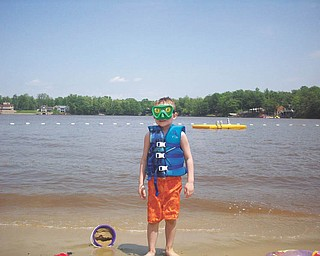 Ryan Lamb, 6, is on the beach at Roaming Shores, Ohio. He is the son of Bruce and DeAnne Lamb of Canfield.