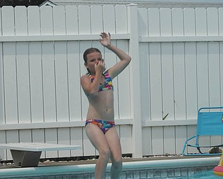 Savannah Wymer, 9, refreshes in the pool at the Poland home of her aunt and uncle, Linda and Randy Estes. Savannah's parents are Marion and Jeff Burns of North Lima. The photo was submitted by Laurie Fox of Lowellville, Savannah's aunt.