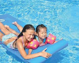 Norma Remias of Canfield sent this picture is of my two granddaughters, Brianna and Jenni-Lin, enjoying floating in the pool on the raft.