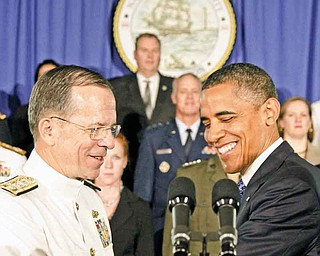 President Barack Obama is greeted by Joint Chiefs Chairman Adm. Mike Mullen, at the Washington Navy Yard in Washington, Friday, Aug. 5, 2011, prior to speaking about efforts to prepare veterans for the workforce. (AP Photo/Carolyn Kaster)
