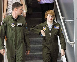 First Lt. Jonathan Blackann escorts honorary Air Force Reserve 2nd Lt.t Connor Covan, 15, of Boardman through the Youngstown Air Reserve Station Wednesday. Covan is the 45th inductee into the program, which began 12 years ago.