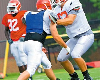 Youngstown State football coach Eric Wolford is looking for vocal leaders, and linebacker John Sasson (53) — the Penguins' leading tackler last season and one of their most-respected players — may be one of the players to fi ll that role.