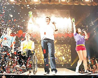 "In this image released by 20th Century Fox, from left, Chord Overstreet, Kevin McHale , Cory Monteith  and Lea Michele are shown in a scene from Glee: The 3D Concert Movie."" (AP Photo/20th Century Fox)"