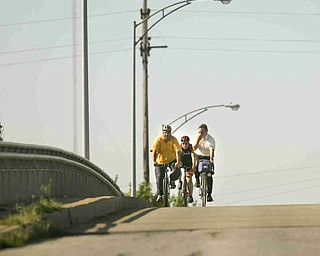 ROBERT K. YOSAY | THE VINDICATOR... Cresting the hill on South Ave Bridge....Ride to work with Franko...Frank Krygowski-- White shirt -- Carl Frost - Orange and Black - Todd Franko in Orange -30-