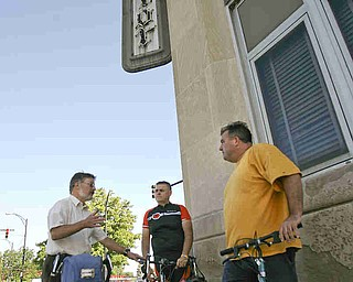 ROBERT K. YOSAY | THE VINDICATOR..At the Vindicator .Ride to work with Franko...Frank Krygowski-- White shirt -- Carl Frost - Orange and Black - Todd Franko in Orange -30-