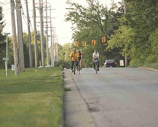 ROBERT K. YOSAY | THE VINDICATOR..Heading down Sheridan - (Mathews Rd is the redlight)..Ride to work with Franko...Frank Krygowski-- White shirt -- Carl Frost - Orange and Black - Todd Franko in Orange -30-
