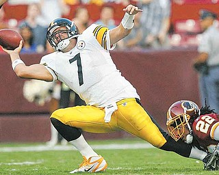 Pittsburgh Steelers quarterback Ben Roethlisberger (7) is pulled down by Washington Redskins cornerback Kevin Barnes during the first half of an NFL preseason football game Friday, Aug. 12, 2011, in Landover, Md. (AP Photo/Patrick Semansky)