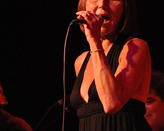 Sue Theofilos of the Sante Fe Band opens for Sarah Turner at Gossip in Austintown.