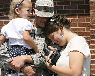 JESSICA M. KANALAS | THE VINDICATOR..Elly Fenstemaker, 3, of Louisville sits in the arms of her father, Spc. Daniel Fenstemaker, who is embraced by his wife, Autumn.... -30-