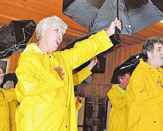 "Beverly Strock rehearses ""Singin' in the Rain."""