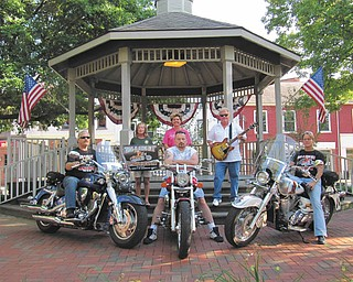 SPECIAL TO THE VINDICATOR   Benefit for humane society:  The Paws-R-Riding-On-It Poker FUNDrun will take place Saturday to benefit the Humane Society of Columbiana County. Entry fee is $15 per couple or $10 for single riders. Registration begins at 10 a.m. at the Steel Trolley Diner in Lisbon and ends with all bikes out at noon. Stops include the Stagecoach Inn in North Georgetown, BB Rooners in Salem and the Original Roadhouse in East Palestine with a return to Guilford Lake Grille in Lisbon. Featured will be guitarist Dave Morgan, boccie, a basket auction, event T-shirts, pull tabs and Best Poker Hand Draw. The event's main sponsor is Carole's Daycare of Wellsville. Pictured are, from left, Glenn Taylor of Paws; Jan Palmer, HSCC Humane Agent; Jenny Pike, HSCC president; James Blaschak, sponsor; Dave Morgan; and Marsha McGinnis of Paws. For more information, call Marsha McGinnis at 330-708-0053 or Glenn Taylor at 330-708-1084.