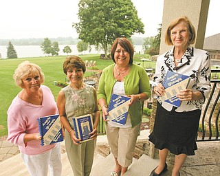 "Robert K. Yosay | The Vindicator: Members of Angels for Easter Seals are preparing to launch their new cookbook, ""Angels and Friends Favorite Recipes, Volume III,"" at The Lake Club in Poland. From left are Jacie Ridel, left, Mary Celeste VanSickle, second from right, and Mary Rossi, right, chairwomen for the event, and Carol O'Neill, president. The newest cookbook has been dedicated to Rossi."