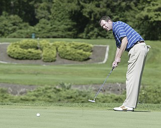 William D. Lewis The Vindicator  Scott Sundstrum, YCC club pro putts.