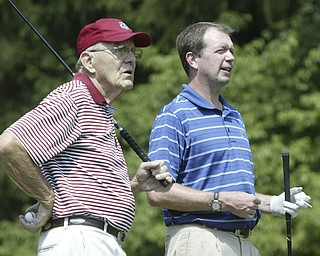 William D. Lewis The Vindicator Bob Albert, left, longtime YCC member and golf enthuiast and club pro  Scott Sundstrom during a recentround att he course which is 100 years old.