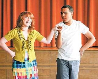 Kaitlyn Cook, 18, and Jason Whitehead, 16, members of the Youngstown Connection song and dance troupe, rehearse at Mahoning United Methodist Church. The group traveled earlier this month to Hawaii to participate in the commemoration of the 70th anniversary of the attack on Pearl Harbor.