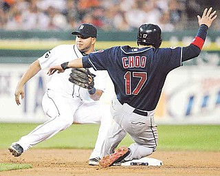 Detroit Tigers shortstop Jhonny Peralta, left, waits for the ball as Cleveland Indians' Shin-Soo Choo, of South Korean, steals second base in the sixth inning of a baseball game, Friday, Aug. 19, 2011, in Detroit. (AP Photo/Duane Burleson)