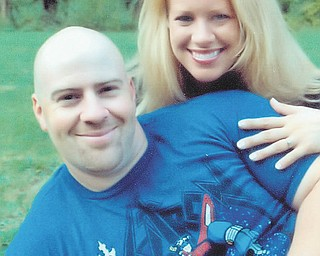 Justin P. Democko and Kristen M. Mikus