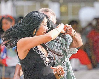 JESSICA M. KANALAS   THE VINDICATOR..Anita Lin of Youngstown dances with her partner during the first Spanish Heritage Festival in Downtown, Youngstown... -30-