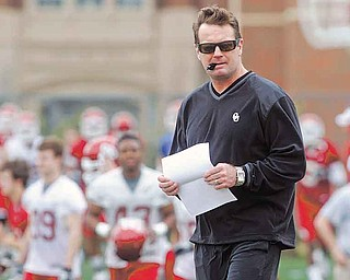 FILE - In this March 21, 2011 file photo, Oklahoma football coach Bob Stoops oversees the first day of spring NCAA college football practice in Norman, Okla. (AP Photo/Sue Ogrocki, File)
