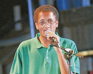 """Boardman High School freshman John Vazquez II raps at the annual """"Jammin' for Jesus"""" festival at the Fairview Arts and Outreach Center in Youngstown."""