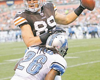 Cleveland Browns tight end Evan Moore celebrates after scoring a two-yard touchdown pass against Detroit Lions safety Louis Delmas (26) in the first quarter during an NFL preseason football game Friday in Cleveland.