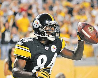 Pittsburgh Steelers wide receiver Antonio Brown celebrates after making a touchdown catch against the Philadelphia Eagles during the first quarter of a NFL preseason football game last Thursday in Pittsburgh.