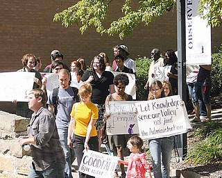 Youngstown State University students carry signs to Williamson Hall, where contract negotiations with faculty resumed Monday afternoon.