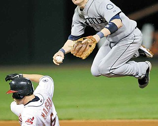 Seattle Mariners second baseman Dustin Ackley avoids Cleveland Indians' Lou Marson (6) but can't relay to first to complete a double play on Indians' Ezequiel Carrera in the seventh inning of a baseball game Monday, Aug. 22, 2011, in Cleveland. (AP Photo/Mark Duncan)