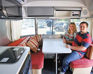 Jessica Clifford of Niles and her fiance, Corey Diles of Braceville, are seen in Clifford's new Airstream Trailer. She won it in a contest sponsored by Little Debbie Foods.