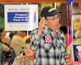 Bill Luoma of Warren makes a point at Tuesday's rally at SCOPE Senior Center in Warren to celebrate the 76th anniversary of Social Security. Luoma, president of Steelworkers Organization of Active Retirees (SOAR), blames the country's poor economy and SS financial woes on the loss of jobs overseas.