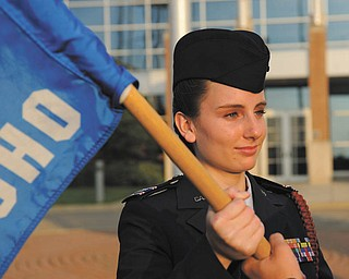 Cadet Capt. Erin Fetters accepts the Youngstown ARS Composite Squadron's guidon as a symbol of the change in command for the Civil Air Patrol unit. She assumed her new position as cadet commander during an Aug. 8 ceremony at the Youngstown Air Reserve Station.