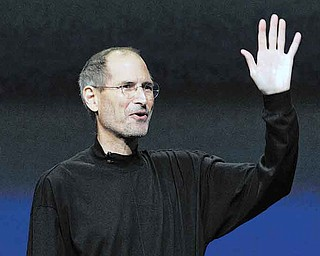 FILE - In this March 2, 2011 file photo, Apple Inc. Chairman and CEO Steve Jobs waves to his audience at an Apple event at the Yerba Buena Center for the Arts Theater in San Francisco. Apple Inc. on Wednesday, Aug. 24, 2011 said Jobs is resigning as CEO, effective immediately. (AP Photo/Jeff Chiu, File)