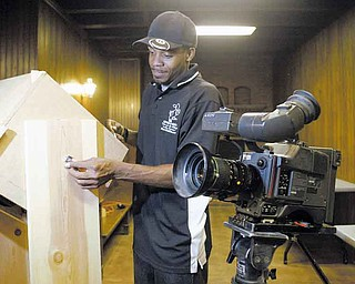 """Filmmaker Brian West of the Method 8 Corp. sets up his equipment before shooting at Pioneer Pavilion in Mill Creek MetroParks. His movie """"Miracle: The Land of Escobar Part One""""  is based on a story he authored."""