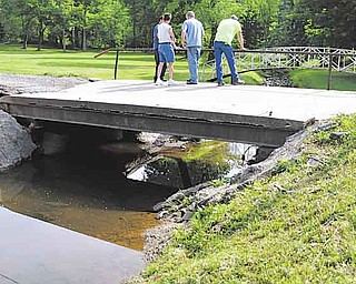 This private bridge at the end of the Haynie family's driveway shows damage after heavy rains caused it to become loose from its foundation. Work to replace the bridge is set to start Monday.