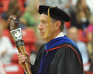 The University Ceremonial Mace leads the professors and students as they enter the Beeghly Center at the 2011YSU Summer commencement....Photo By:  Lindsay Y McCall   The Vindicator